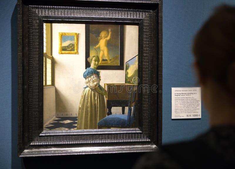 看扬・弗美尔的绘画全国galleryin的伦敦访客 图库摄影