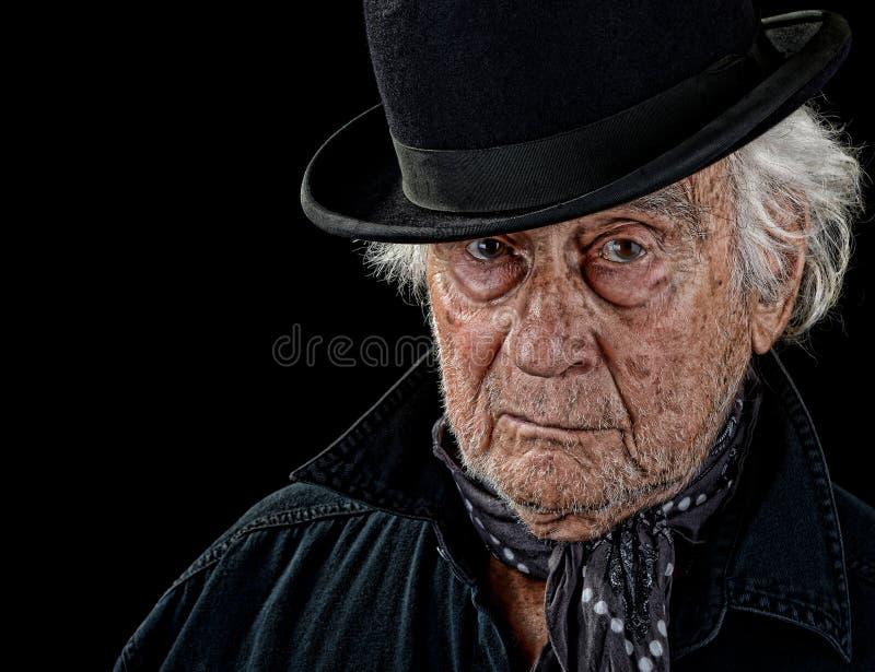 戴圆顶硬礼帽的老人 库存照片