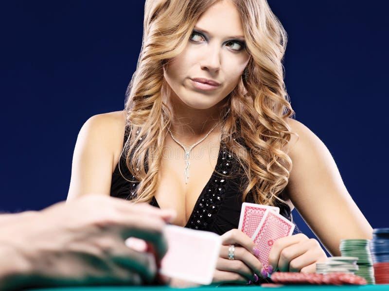 看板卡怀疑赌博的符合妇女 免版税图库摄影