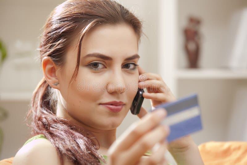 看板卡赊帐电话购物 库存照片