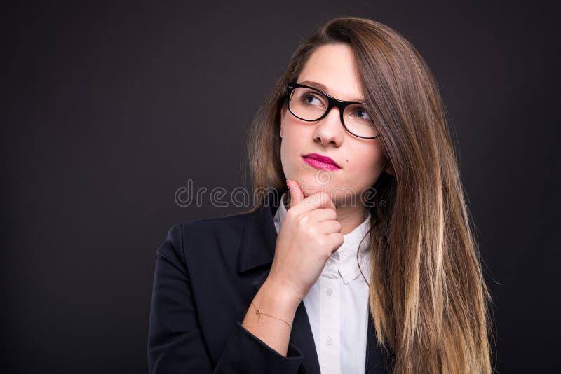 看沉思企业的女性画象  免版税库存照片