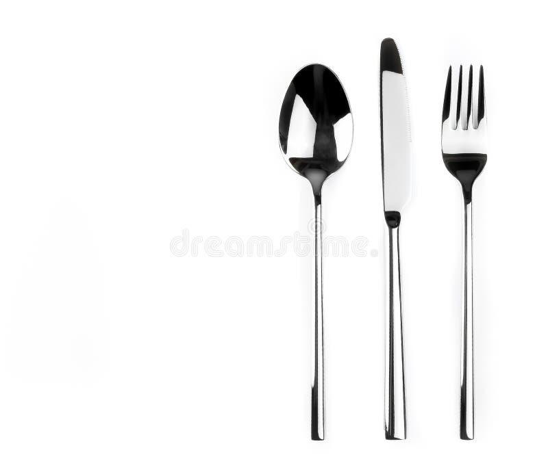 看法上面在白色背景和叉子隔绝的匙子、刀子 图库摄影