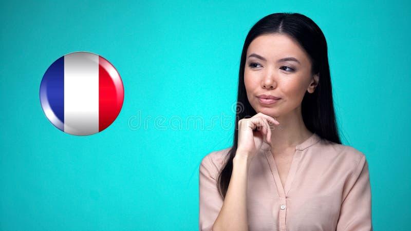 看法国旗子标志,国际学生交换节目的相当夫人 免版税库存照片