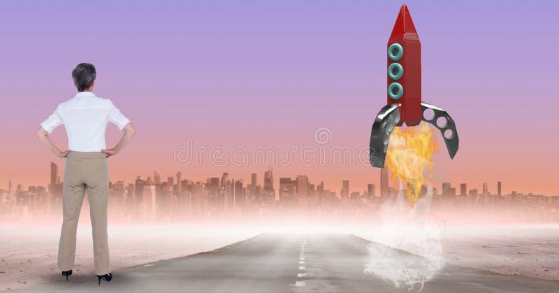 看火箭发射节目的数字式综合图象女实业家背面图 免版税图库摄影
