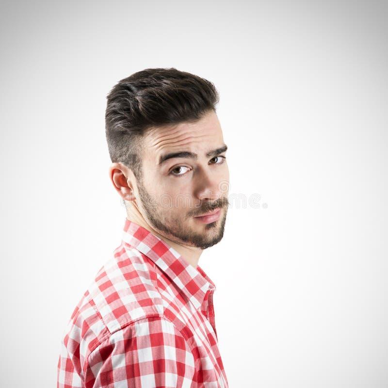 看照相机的玩事不恭的有胡子的人画象  库存图片