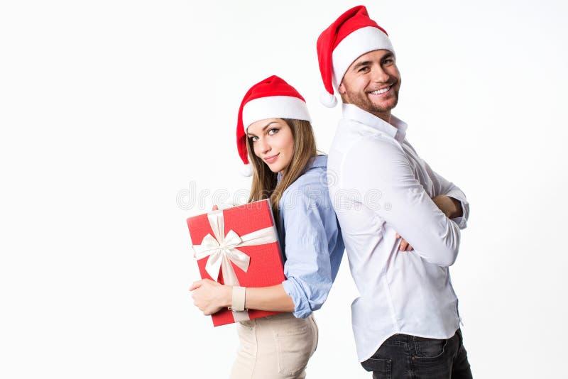 看照相机的美好的愉快的圣诞节夫妇 库存图片