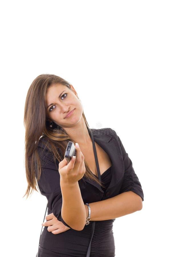 看电视的乏味女商人和那里是没什么interestin 免版税库存照片