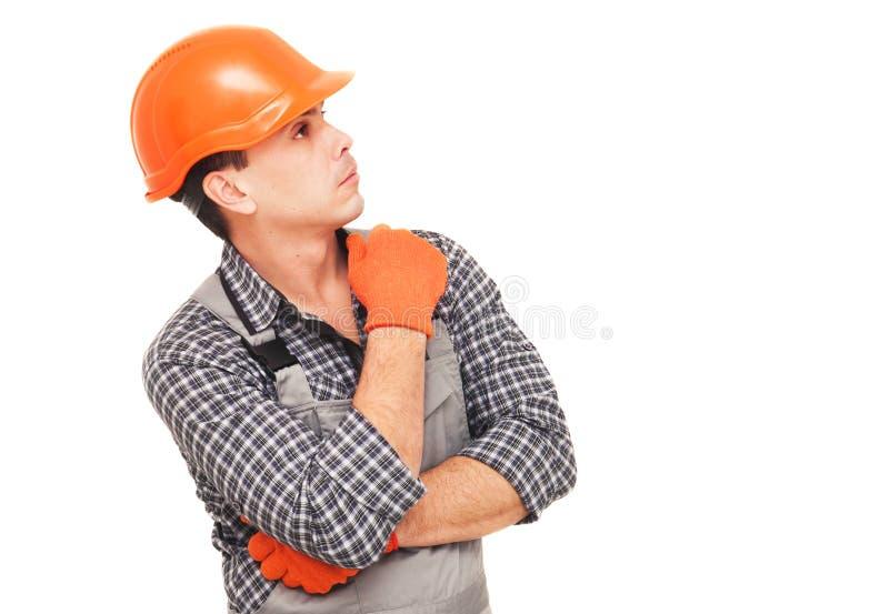 看的建筑工人认为和  免版税库存图片