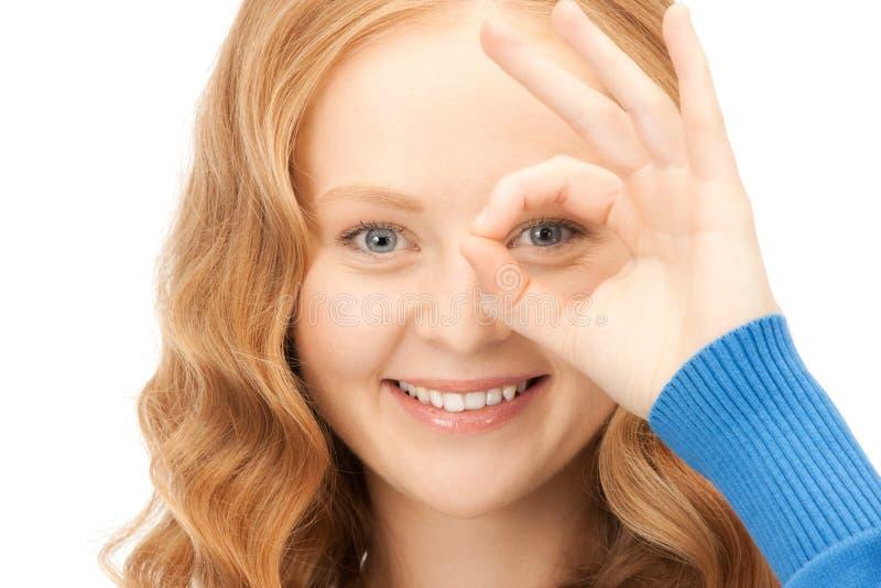 看起来可爱的妇女的指孔 库存图片
