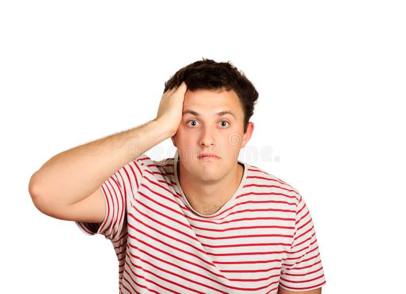 看起来年轻人演播室的射击冲击用在头的手 在白色背景隔绝的情感人 库存照片