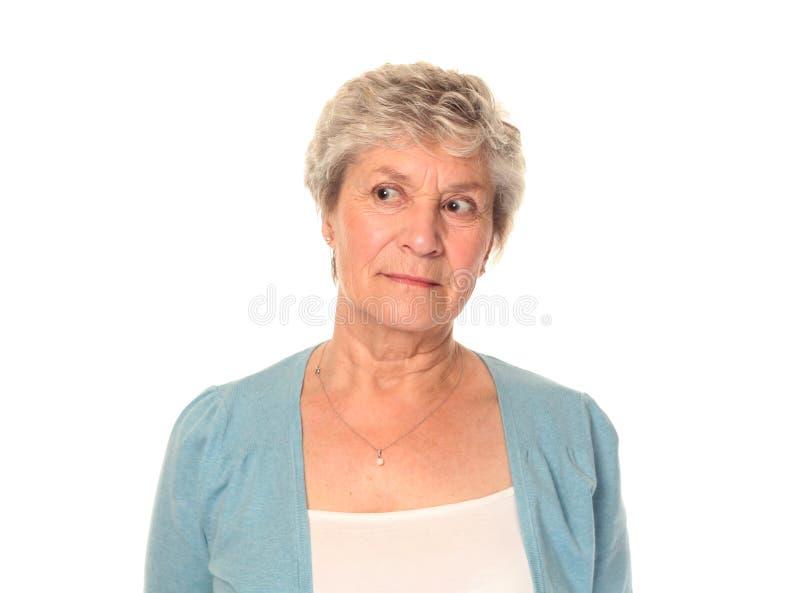 看起来更老的高级妇女的左 免版税库存图片