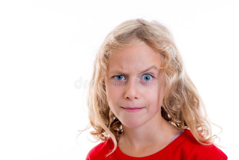 看起来白肤金发的女孩怀疑与眼眉 免版税库存图片