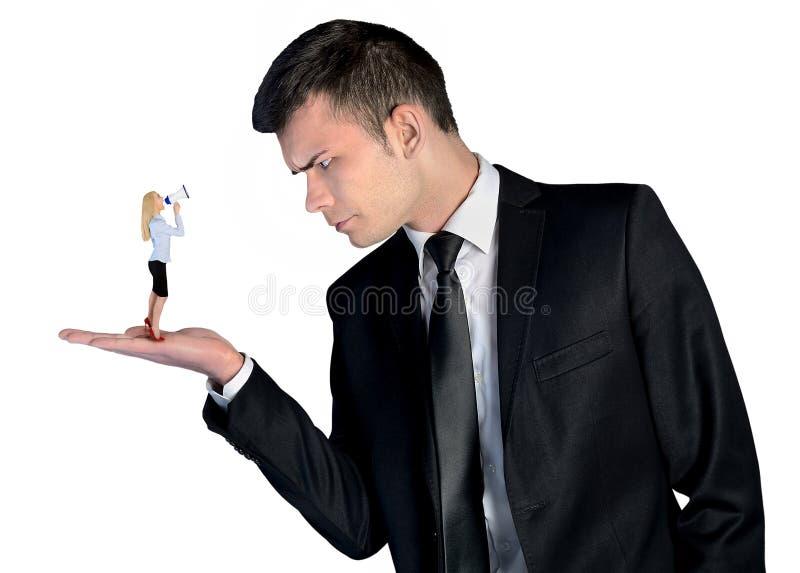 看起来的商人恼怒在小妇女 库存照片