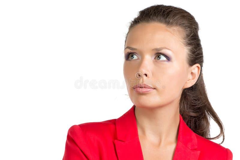看起来红色的衣服的女实业家正确 库存图片