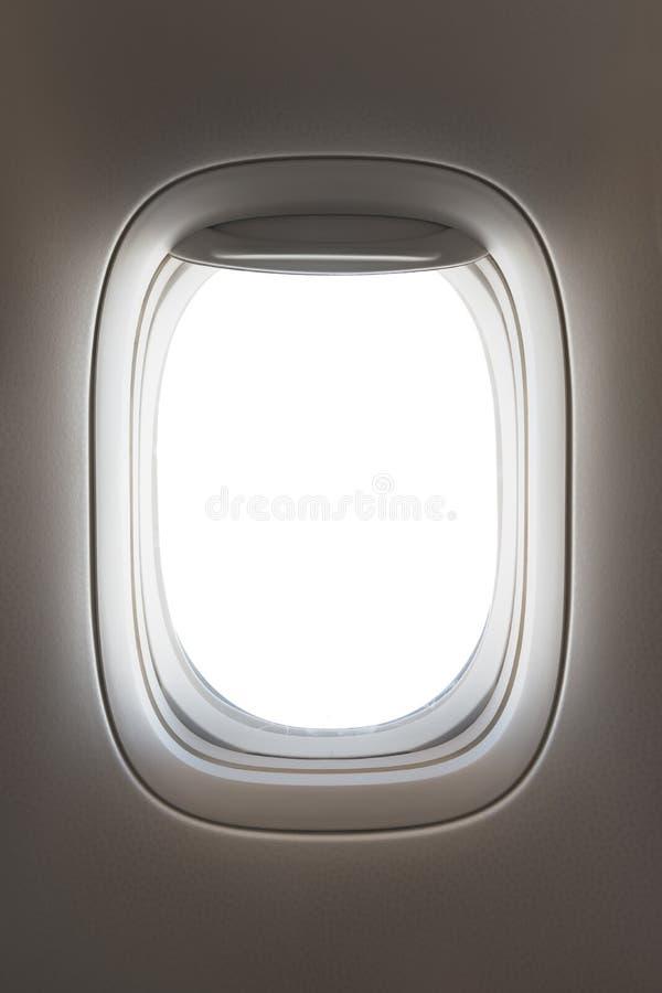 看通过一个大喷气机客机窗口 免版税库存照片