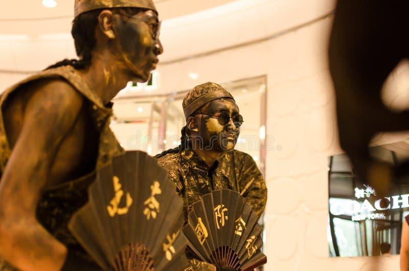 真实展示的古铜模仿,佩带一一百年在中国清代服装和确凿的证据前 免版税库存照片
