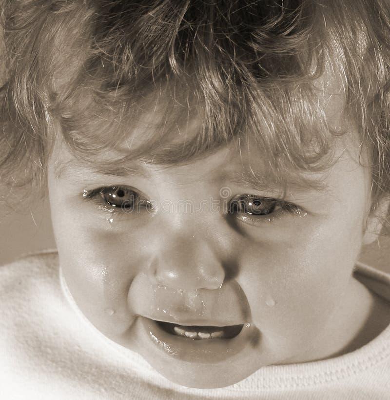 眼泪汪汪的小孩 库存图片