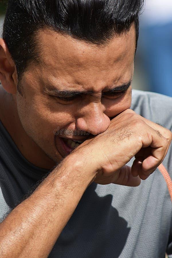 眼泪汪汪的成年男性运动员 库存图片