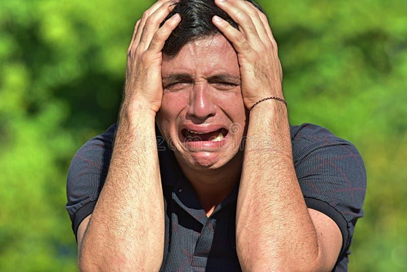 眼泪汪汪的成年男性 库存图片