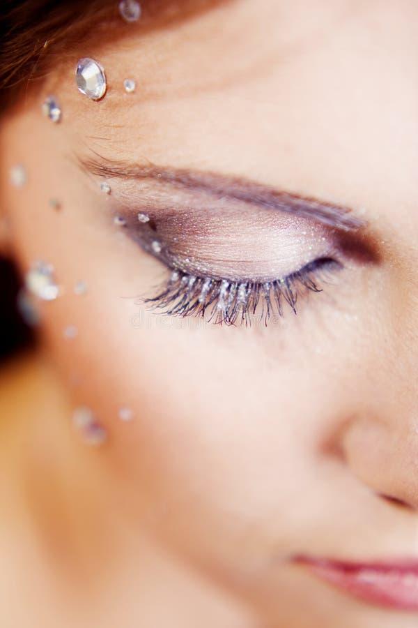 眼睛表面一半组成闪闪发光 库存照片