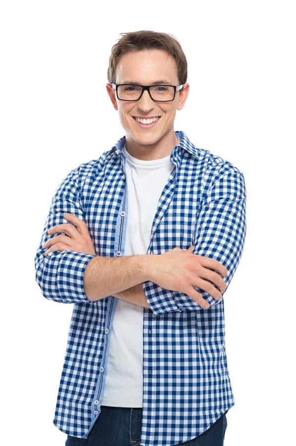 戴眼镜的愉快的年轻人 免版税库存图片