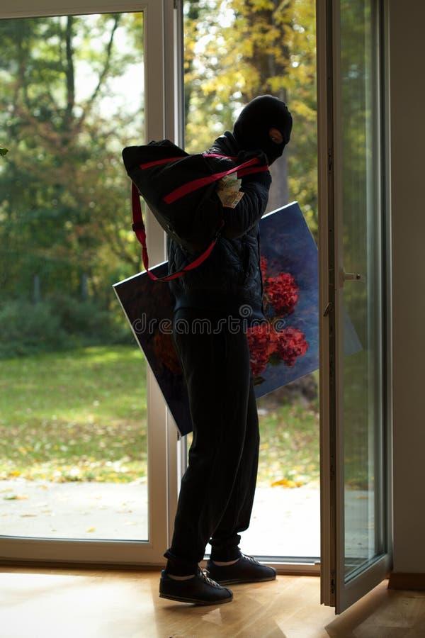 戴着面具的侵入家宅者 免版税库存照片