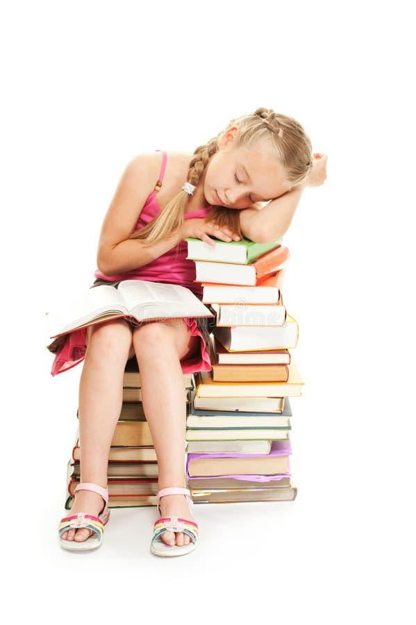 睡着的秋天女小学生年轻人 免版税库存照片