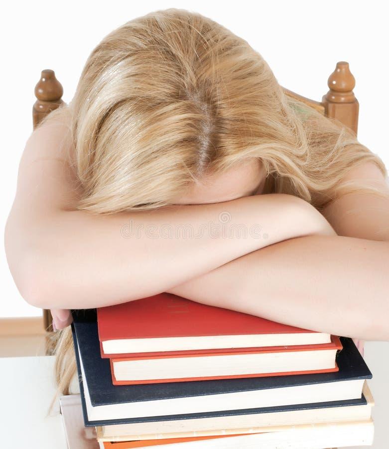 睡着跌倒了学员疲倦 免版税库存照片