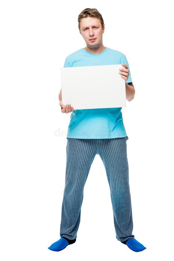 睡衣的人在白色背景举行一张招贴 免版税库存图片