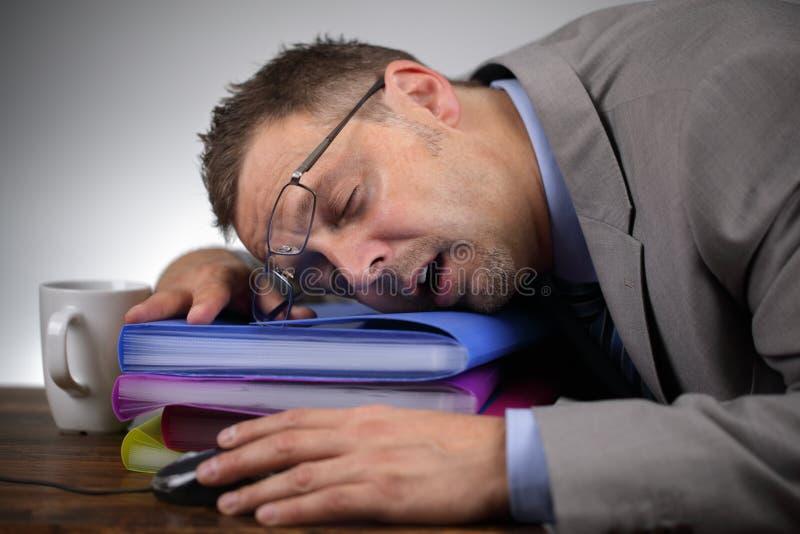 睡觉在工作 免版税库存照片