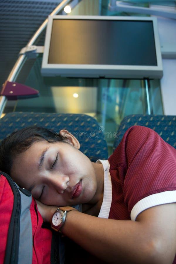 睡觉在火车的妇女 库存图片