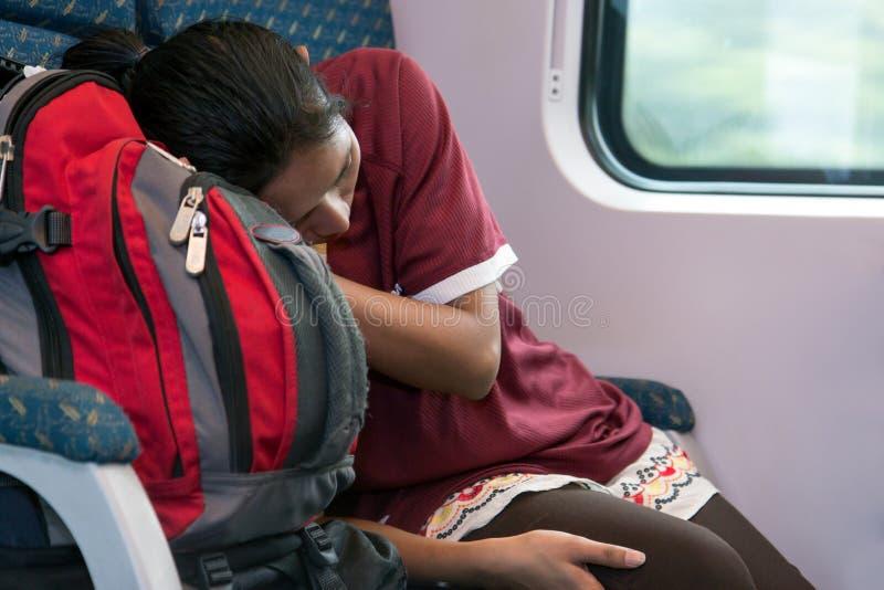 睡觉在火车的妇女 库存照片