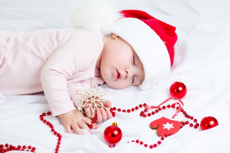 睡觉的圣诞节女婴 图库摄影