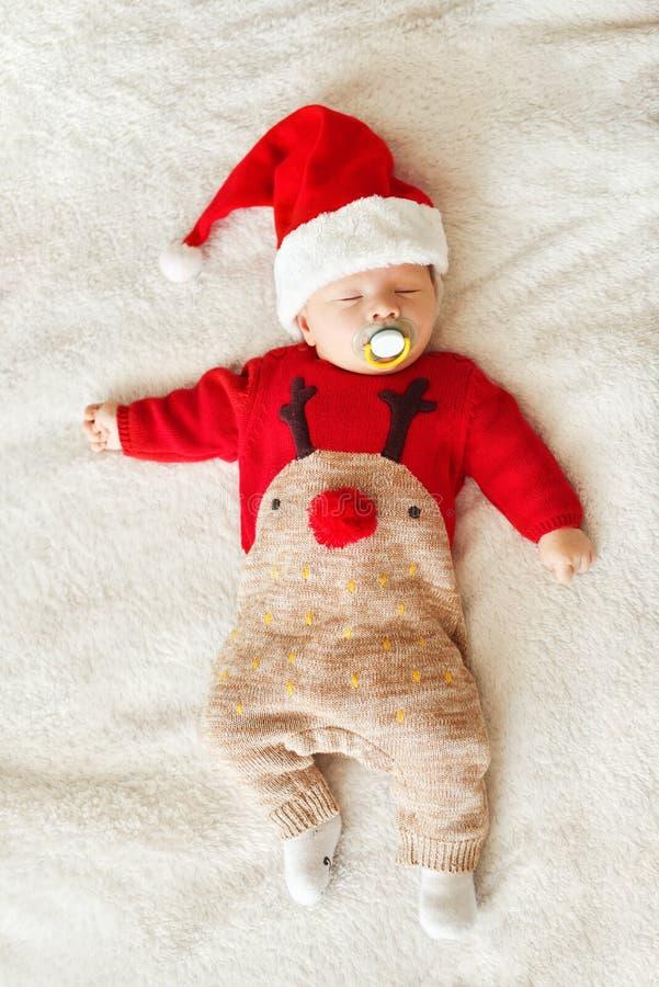 睡觉的圣诞节婴孩 免版税库存图片