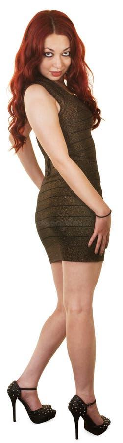 短的礼服的俏丽的妇女 免版税图库摄影