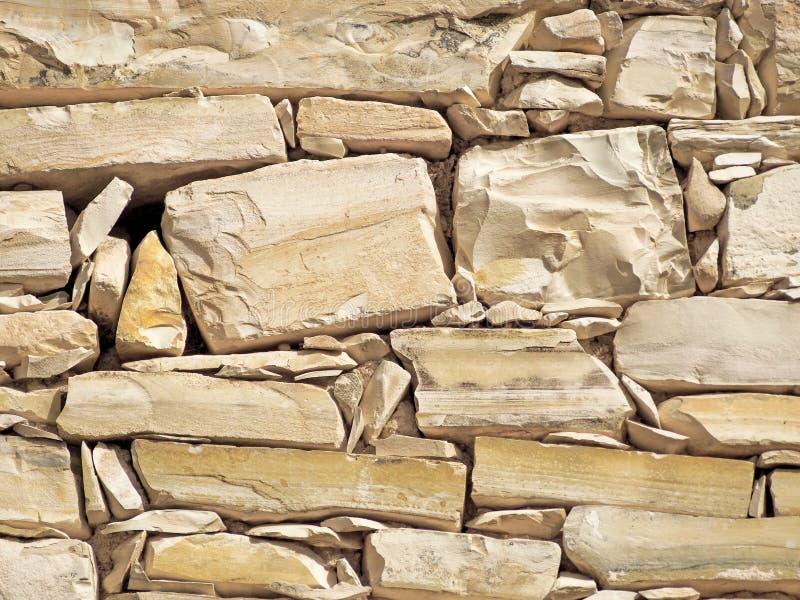 石墙纹理,米黄颜色 免版税库存图片