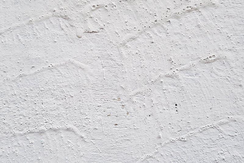 石墙绘与白色油漆,背景,纹理 库存图片
