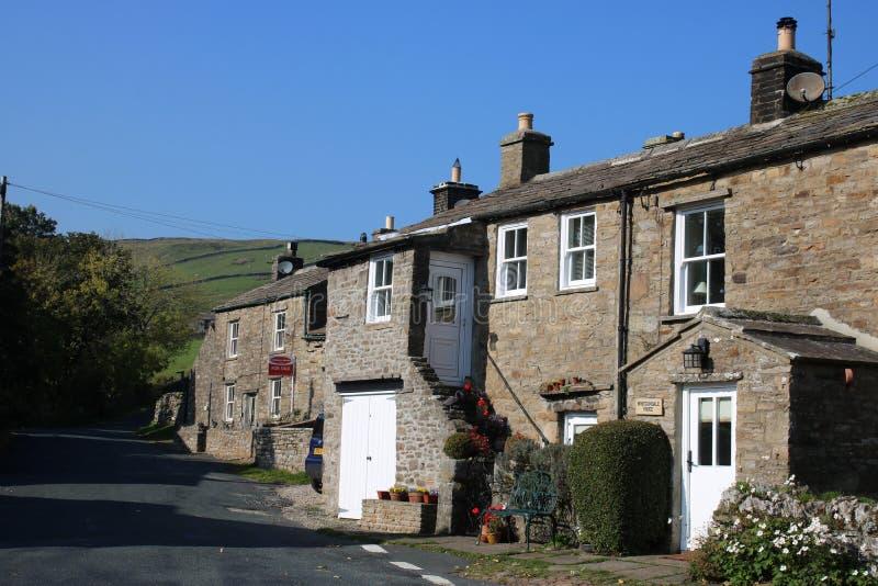 石头在Thwaite,Swaledale,英国修造了村庄 库存图片