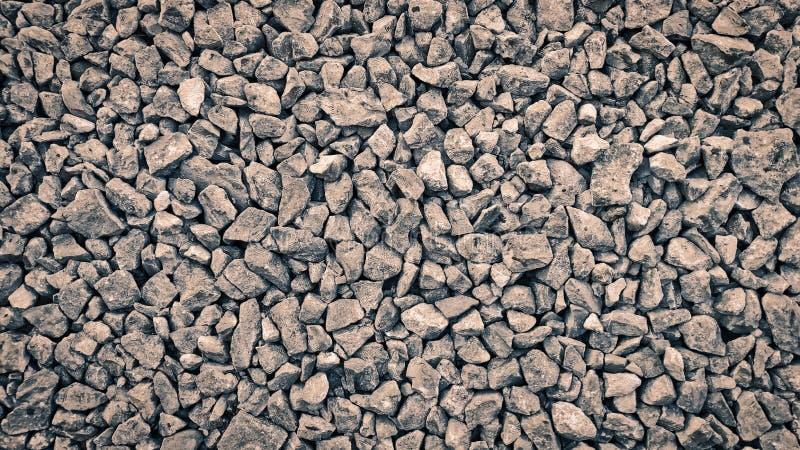 石头瓦砾特写镜头的背景影像图片堆了在彼此顶部棕色树荫 免版税图库摄影