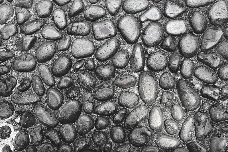 石岩石黑暗的纹理剧烈的照明设备 免版税库存照片