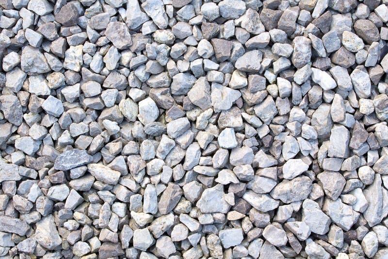 石渣纹理 小石头、小石城、小卵石在灰色许多树荫下,白色和蓝色 小石城纹理  库存照片