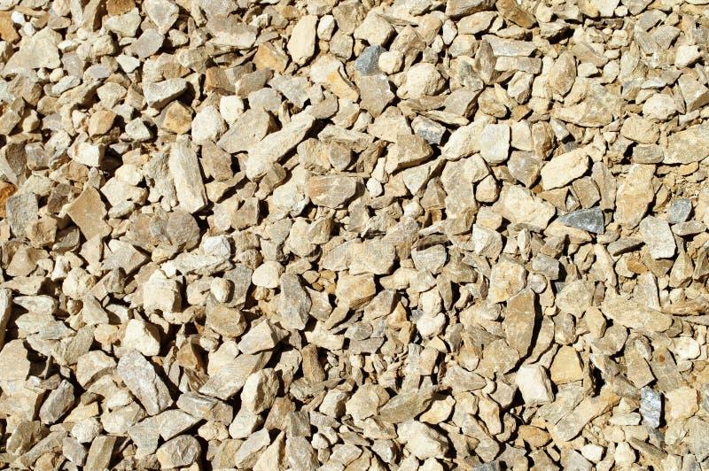 石灰米黄被击碎的石头  库存图片
