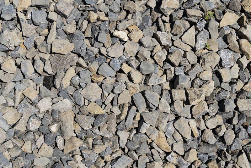 石石渣灰色纹理  石头瓦砾灰色倾吐的堆特写镜头 石道路与 库存图片