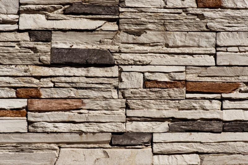 石砖墙无缝的背景-构造连续的复制品的样式 免版税库存照片