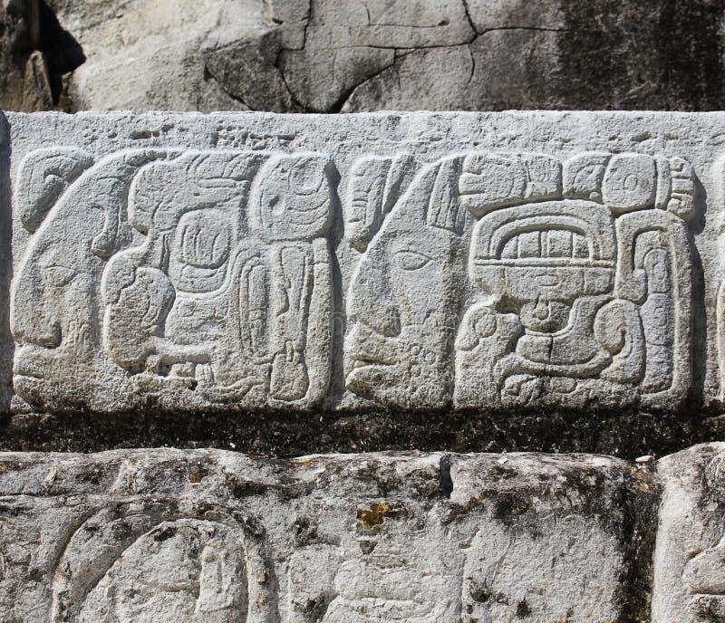 石雕刻。墙壁的片段 免版税库存照片