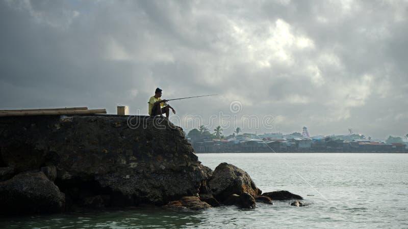 码头的渔夫 免版税图库摄影