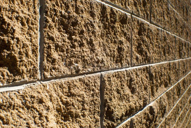 砂岩砖墙 免版税库存图片