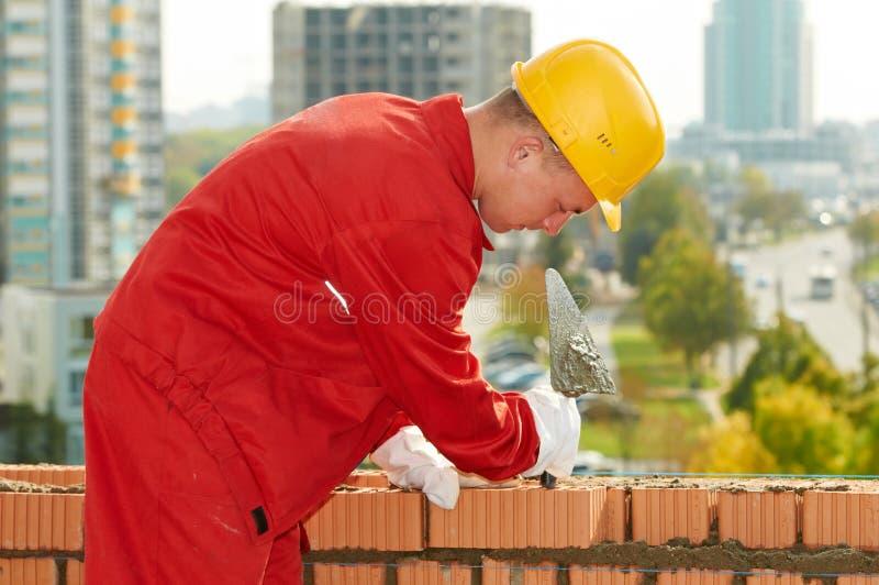 砌砖工建筑泥工工作者 免版税库存照片