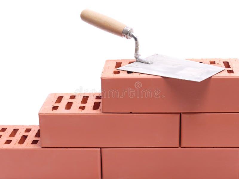 砌砖镘刀墙壁 库存照片