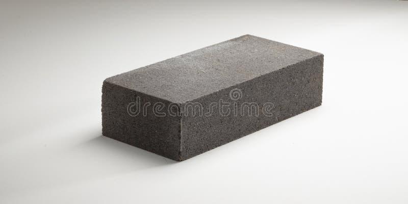 砖光滑的混凝土用不同的颜色 在一个空白背景 免版税库存照片